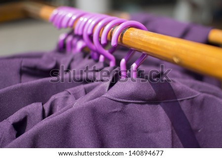 row of cloth hangers with coats