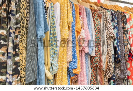 Row of cloth summer dress on clothes shop clothing store