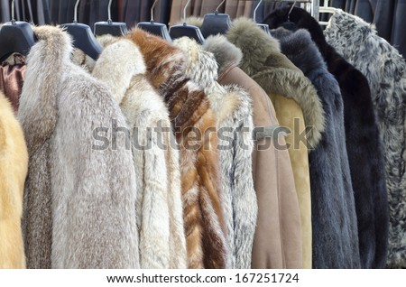 Row of coats made of animal fur #167251724