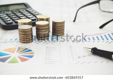 Row of coins,calculator with account book finance and banking concept for background.concept in grow and walk step by step for success in business. concept of saving money. #603869357