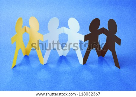 Row of Color Paper Chain figurines Holding Hands on Blue Background