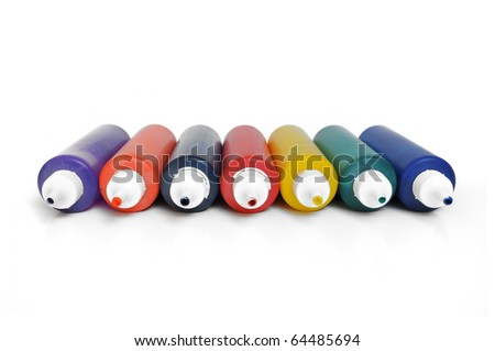 Row of color tubes on white background