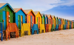 Row of colorful bathing huts in Muizenberg beach, Cape Town, South Africa
