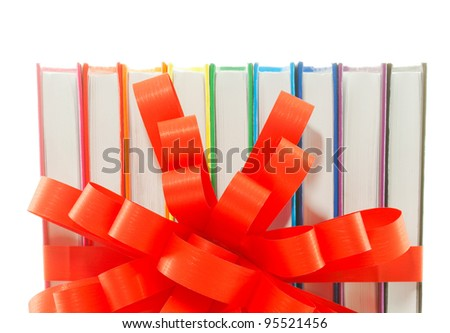 Row of colorful books tied up with ribbon isolated on white - stock photo