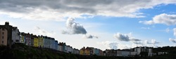 row of colorful clifftop houses overlooking Tenby Bay