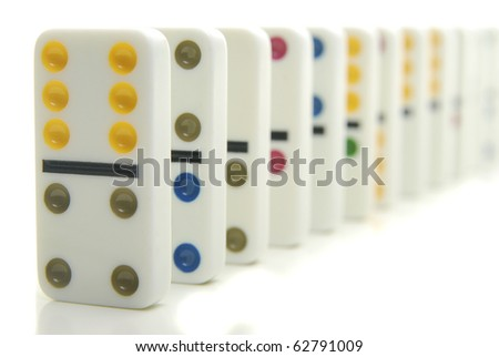 Row of colorful dominos isolated on white.