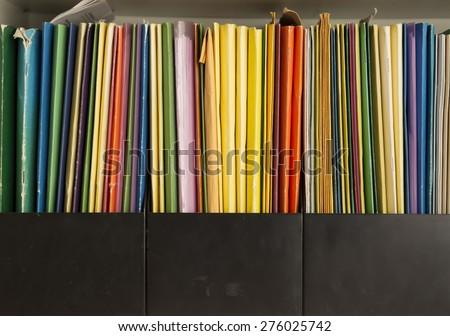 Row of colorful folders #276025742
