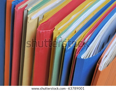 Row of colorful folders with documents