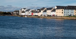Row of colorful houses at the Long Walk, Galway, Ireland.