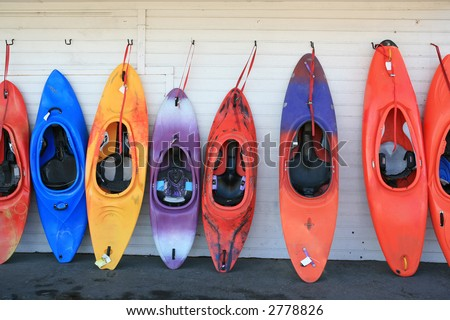 Row of colorful kayaks
