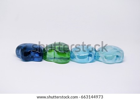 Row of Colors crystal rocks closeup on white background #663144973