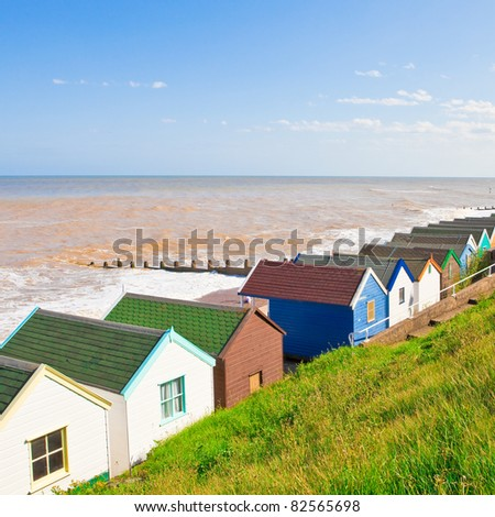 Row of colourful beach huts at Southwold, England