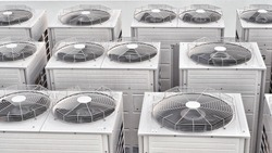 Row of compressor air conditioner on the roof high building
