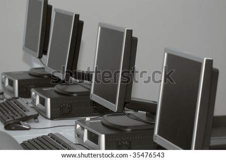 Row of computers set up for training at a classs room