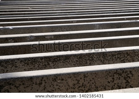 row of concrete temporary boundaries for road construction sites in bright sunshine #1402185431