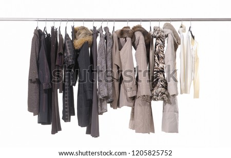 Row of different clothes for females on hanging
