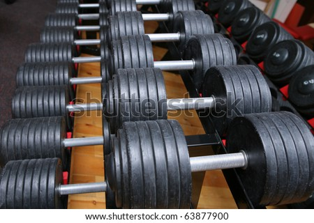 row of dumbell weights in gym room. for lifting or fitness.