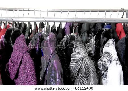 Row of elegant female fashion coat on hanging
