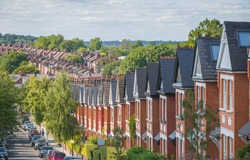 Row of English terraced houses on hilly area in Crouch End, North London