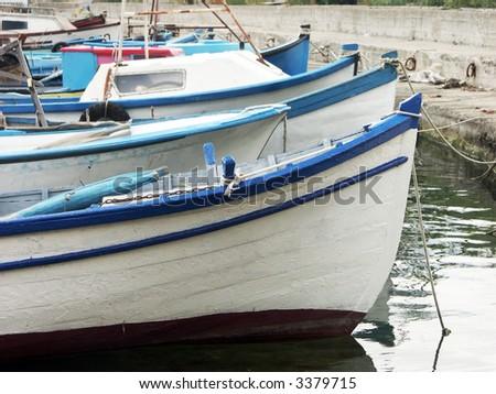 Row of fisherman\'s boats wharfed at harbor