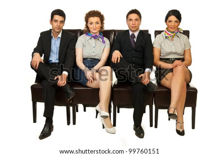 Row of four business people team standing on chairs with legs crossed and waiting isolated on white background