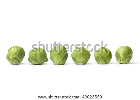 Row of fresh Brussel sprouts  on white background