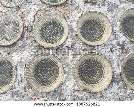 Photo of  Row of glassy circle bricks in light transmissive ceiling. Safety tilled  ceiling above production of explosive.