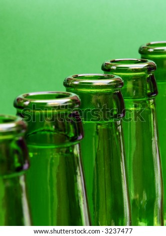 Row of green bottles with focus on center bottle
