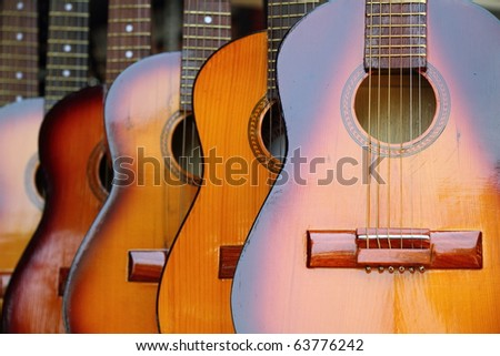 Row of Guitars in a Shop in Phnom Penh - stock photo