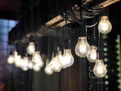 Row of hanging light bulb. Selective focus.