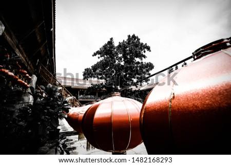 Row of hanging oriental Chinese red lanterns