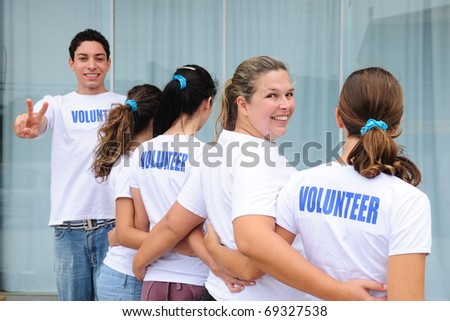 row of happy and diverse volunteer group smiling