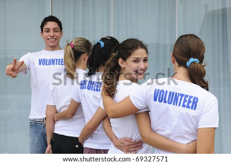 row of happy and diverse volunteer group smiling - stock photo