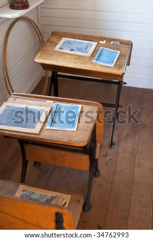Row of heritage school desks with small chalkboards