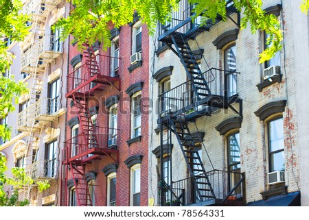 Row of historic New York City tenement apartments from the 19th century