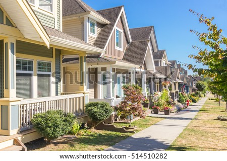 Row of houses and town homes on a sunny day.