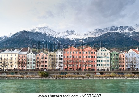 Row of Houses in Innsbruck, in the Background the austrian Alps