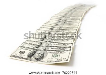 Row of hundred dollar bills isolated on white background