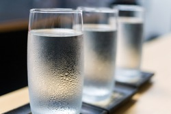 row of ice cold water glass