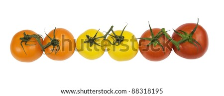 row of juicy organic tomatoes on a white background