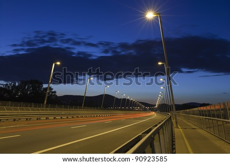 Row of lamp post at the end of a road bridge, night shot.