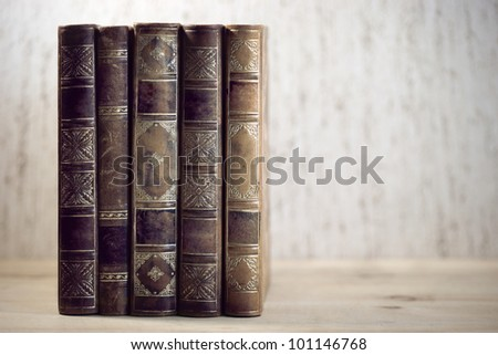 Row of leather vintage books on shelf