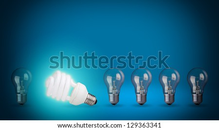 Row of light bulbs and energy save bulb Idea concept on blue background
