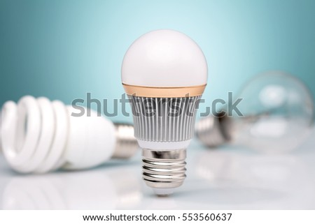 Row of light bulbs.Idea concept on blue background. #553560637