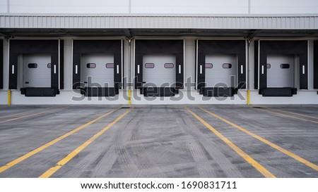 Row of loading docks. Warehouse building.