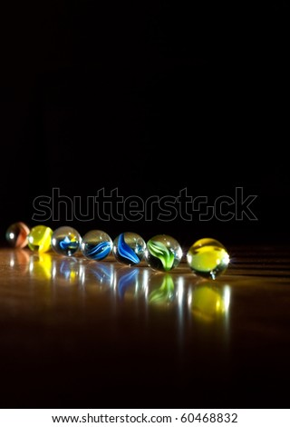 Row of Marbles in One-Point Lighting Background