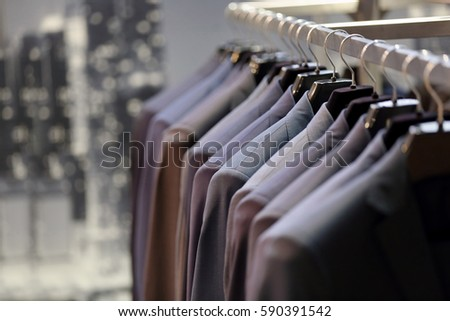 Row of men's suits hanging on hanger