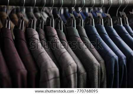 Row of men suit jackets on hangers #770768095