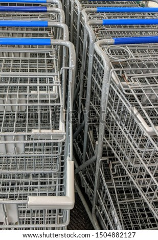 Row of metal grocery carts #1504882127