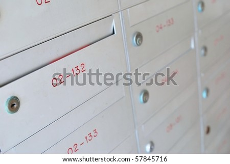 Row of metallic letter boxes for concepts such as safety and security, business communication and concepts.